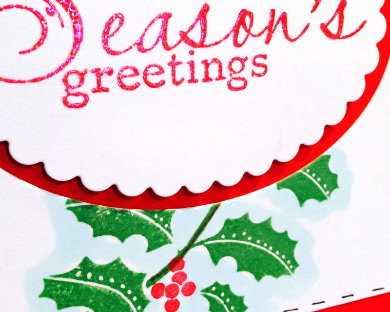 Season's greetings holly card close up