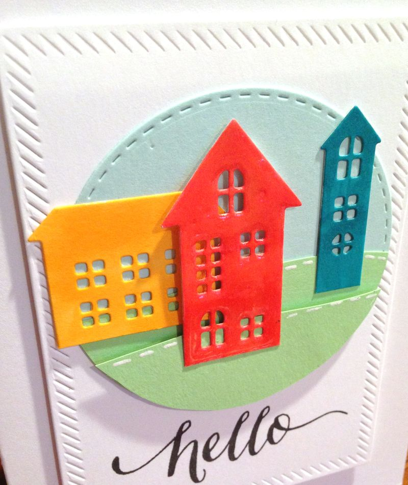 Three houses hello card close up